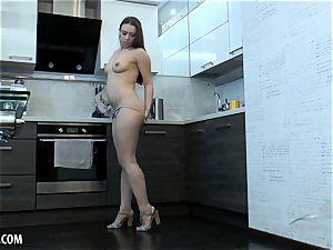 Russian unshaved babe masturbates in the kitchen