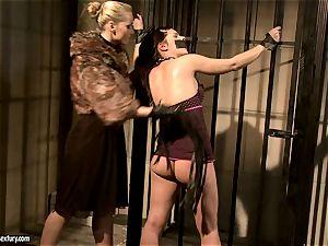Kathia Nobili in fur covered jacket torturing a torrid honey