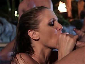 Julia Ann inhales a group of chisels in a pool