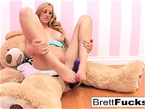 Brett Rossi plays with a strap-on fake penis